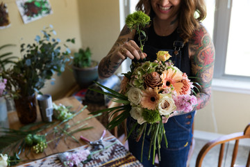 Floral Designer working on arrangement