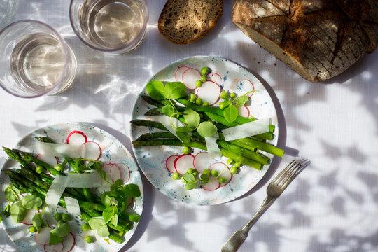 Early summer salad of asparagus, radish, peas, pea shoots and pecorino.