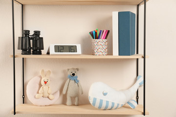 Shelves with toys and kids stuff in child room
