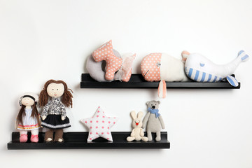 Different stuffed toys on shelves in child room