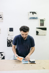 Artist working with picture miniatures