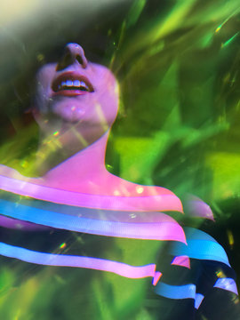 Close up of woman and green leaves, double exposure