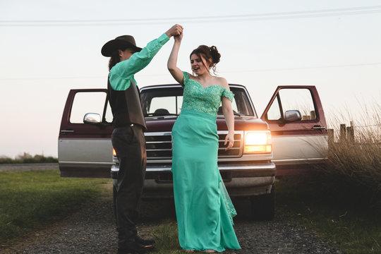 teenage couple having fun on way to high school prom