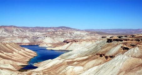Band-e Amir lakes near Bamyan (Bamiyan) in Central Afghanistan. Band e Amir was the first national park in Afghanistan. This is the panorama from a viewpoint on the road to Band e Amir, Afghanistan.