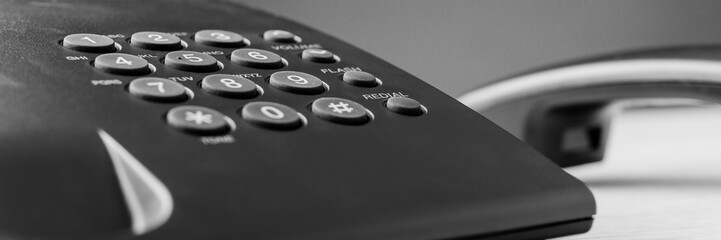 Wide view image of black landline telephone keypad