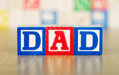 Dad Spelled Out in Alphabet Building Blocks