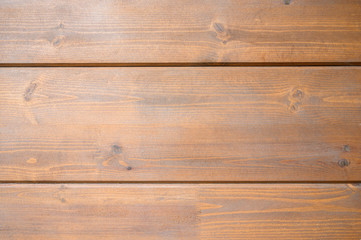 Wall texture of new wooden house painted with natural brown oil color.