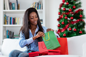 African american woman after shopping christmas gifts