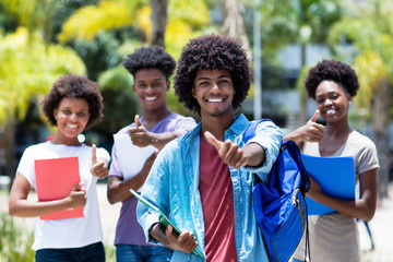 Successful african american university student with group of african american students