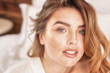 Beauty portrait of woman with freckles.