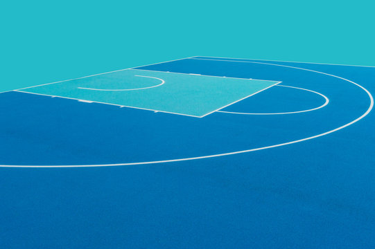 Abstract, blue background of newly made outdoor basketball court
