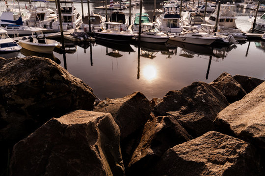 Reflection of the sunset at the rocky pier with docked yacht - Harbor View, Stamford, Connecticut