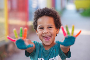 beautifu happy boy with painted hands