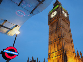 LONDON - 2016:  Two of its most recognizable icons, Big Ben and the Underground sign, appear together outside Westminster station, as seen in London circa 2016..