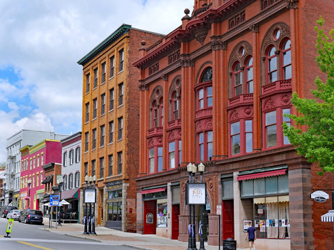 GENEVA, NY, USA - MAY 2019:  This town in the Finger Lakes has numerous well preserved19th century buildings, including these colorful main street storefronts.