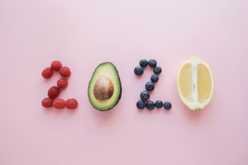 Foto op Aluminium Eten 2020 made from healthy food on pink pastel background, Healhty New year resolution diet and lifestyle
