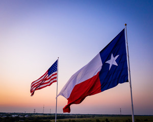 Canvas Prints Texas American and Texas Flags against sky | Flags at Sunset with heavy vignette