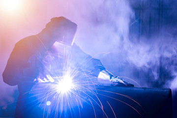 Industrial welders, industrial steel pipe parts, welding workers, steel workpieces