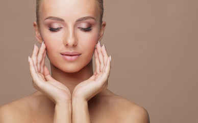 Beautiful face of young and healthy woman. Skin care, cosmetics, makeup, complexion and face lifting.