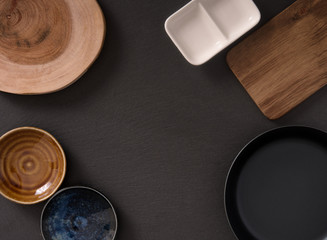 A frame of empty saucers, boards and a frying pan