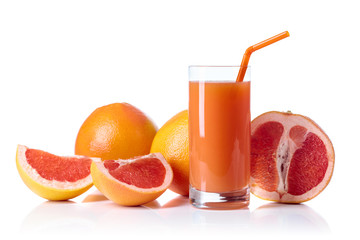 Poster Sap Glass of fresh grapefruit juice and cut fruits white background.