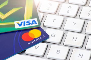 SAN PELLEGRINO TERME, ITALY - NOVEMBER 29, 2018: VISA and MASTERCARD credit cards supported on a computer keyboard