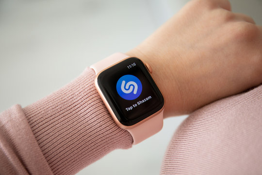 Woman hand with Apple Watch Series 4 music service Shazam