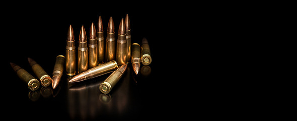 Bullet isolated on black background with reflexion. Rifle bullets close-up on black back. Cartridges for rifle and carbine on a black.