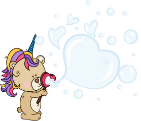 Teddy bear with unicorn horn blowing soap bubbles