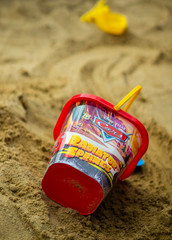 Disney Cars plastic toy bucket laying on sand on August 25, 2018 in Poznan, Poland.