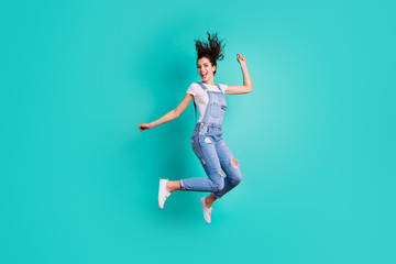 Full length body size view of her she nice attractive cheerful cheery glad carefree girl wearing overall jumping having fun free time isolated on bright vivid shine vibrant green turquoise background Wall mural