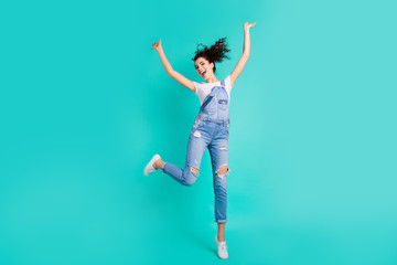 Full length body size photo of charming cute cheerful positive girlfriend rejoicing with victory of something while running isolated with turquoise bright color background Wall mural