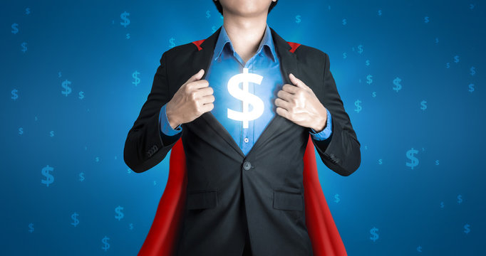 Super business man wears black suits and red robes with super heroes winner concept on a lot of money dollars background and riches. Investors receive a lot of profits with business success.