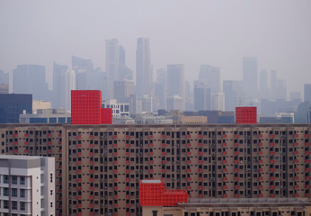 The skyline of the central business district and public apartment blocks are seen during haze in Singapore