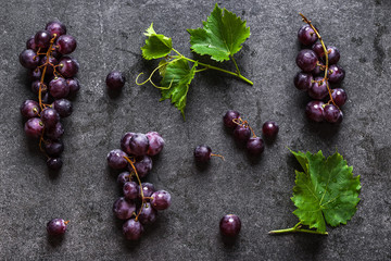 Fresh red grapes on dark background