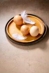 Fresh eggs on plates, Easter concept