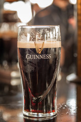 DUBLIN, IRELAND  Close up of a glass of Guinness stout beer on a bar counter in Dublin, Ireland