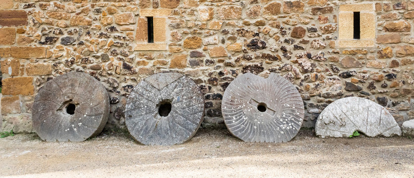 old stone wheels, with which flour is milled