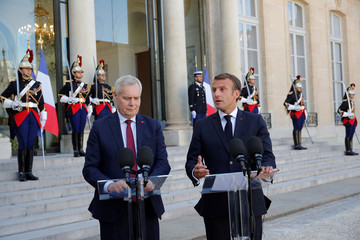 French President Emmanuel Macron and Finland's Prime Minister Antti Rinne deliver a joint statement at the Elysee Palace in Paris