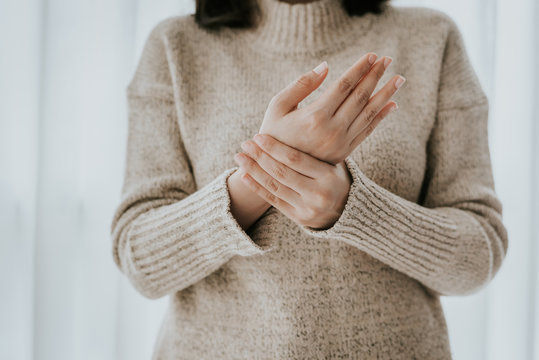 woman holding her wrist pain