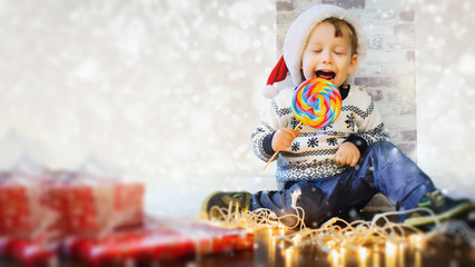 Happy child eats sweets at christmas