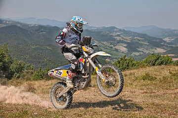 bikers riding enduro motorcycles Husqvarna 450