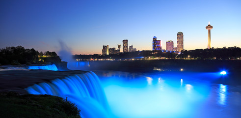 Niagara Falls at dusk including the skyline of the Canadian city of the background Wall mural