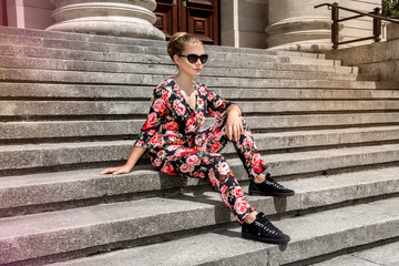 Fashionable stylish beautiful young model in summer autumn floral clothes posing in the street - Image