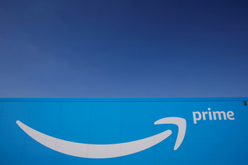 The logo of Amazon Prime Delivery is seen on the trailer of a truck outside the company logistics centre in Boves
