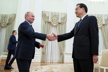Russian President Vladimir Putin and Chinese Premier Li Keqiang shake hands during their meeting in Kremlin, Moscow