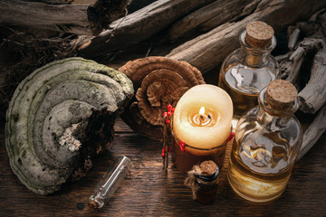 Magic potion bottles on a wizard table. Herbal medicine with dried ingredients on the table background. Witch doctor concept.