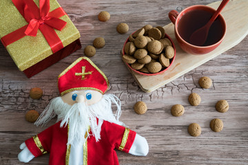 Golden present, cup of tea, Dutch Kruidnoten and Sinterklaas Doll. Special event in Belgium and The Netherlands, called Sinterklaas