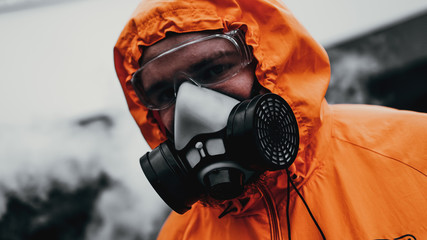 Protection respirator half mask for toxic gas.The man prepare to wear protection air pollution in the chemical industry