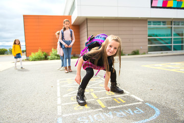 Fototapeta A Hopscotch on the schoolyard with friends play together obraz
